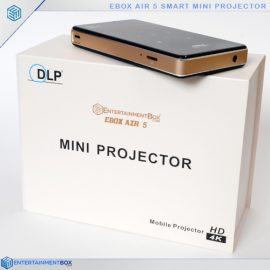 pocket projector sitting on top of box